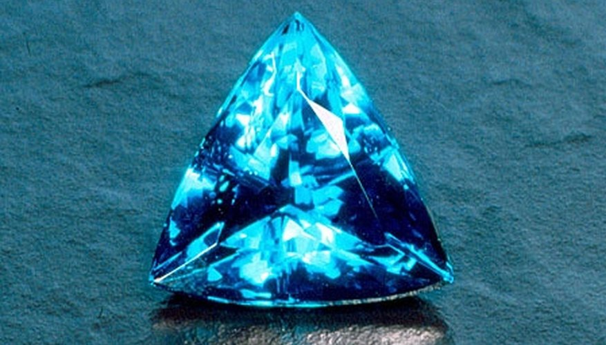 Paraiba tourmalines are a clear, ocean blue but will also emit green