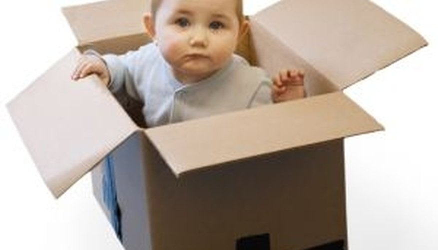 Make a cardboard box even more exciting by crafting a castle playhouse.