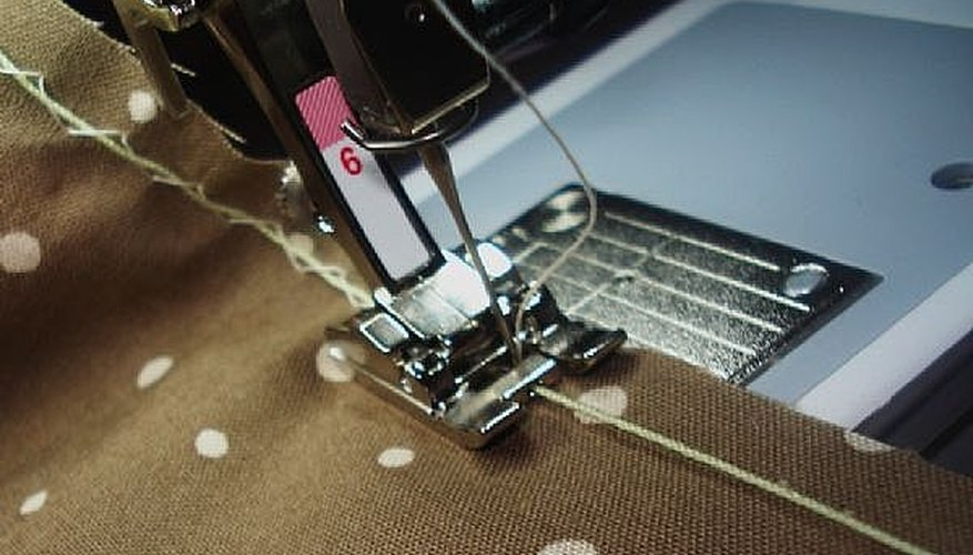Use the lines on the sewing machine plate as your guide to sew straight lines.