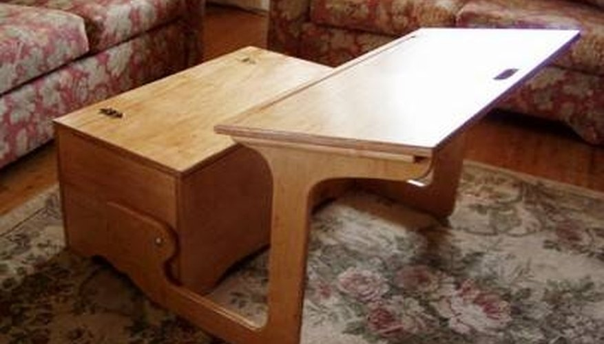 This desk has storage in the seat and the writing surface folds up to form a bench.