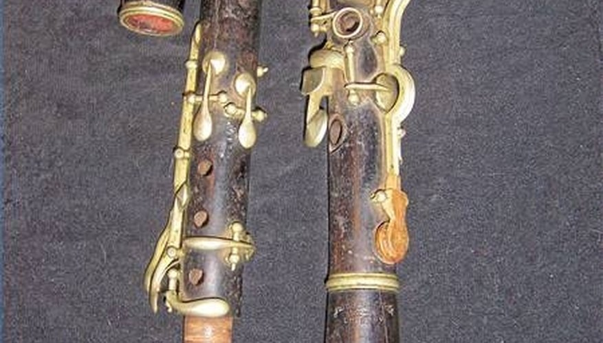 Very old clarinet in D. Note the red string around the tenon joint and the wooden key.