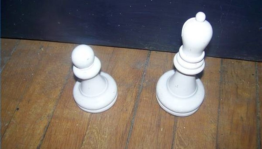 Lawn chess pieces crafted from wood and painted