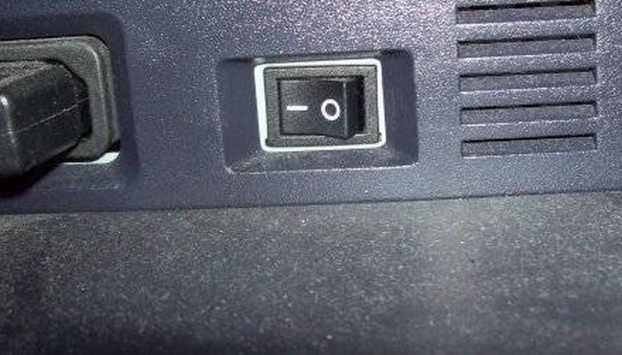 Power toggle in back of printer