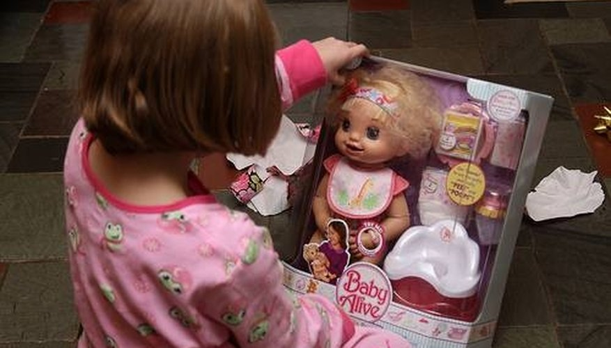 Girl with new Baby Alive doll.