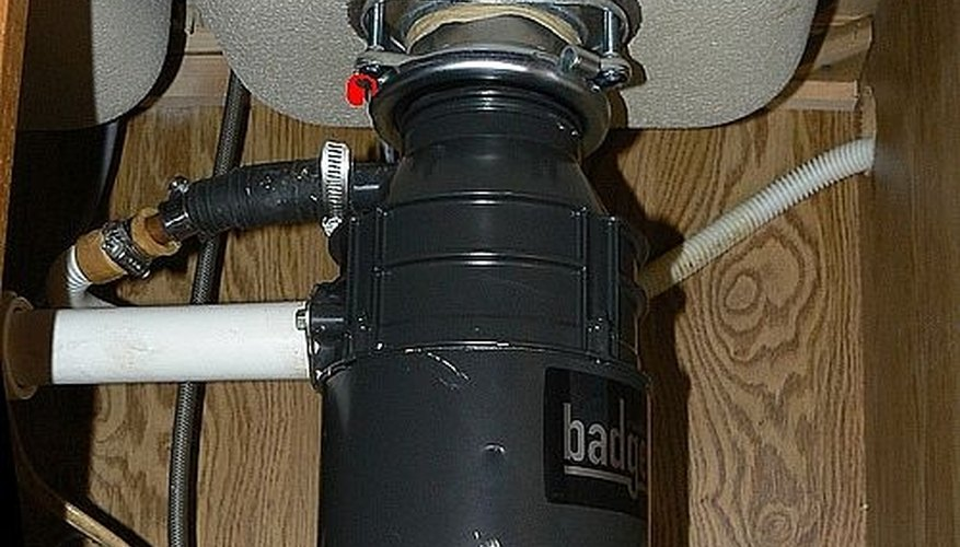Garbage disposal/disposer photo showing retainer ring in red.