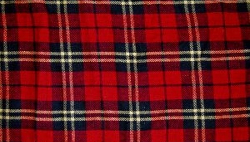 Bring in a bold plaid fabric or a family tartan.