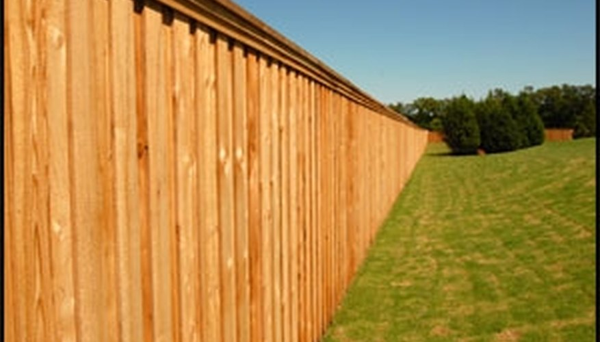This cedar stockade style fence has a clear sealant applied to preserve the color of the wood.