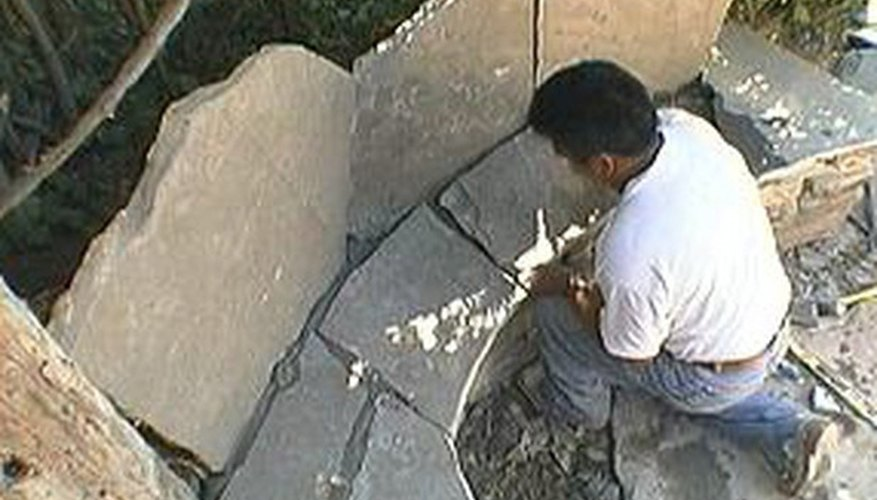 Place smaller flagstone pieces on the base.