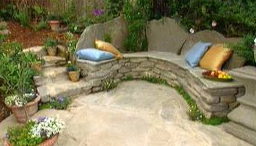A stone bench blends with nature.