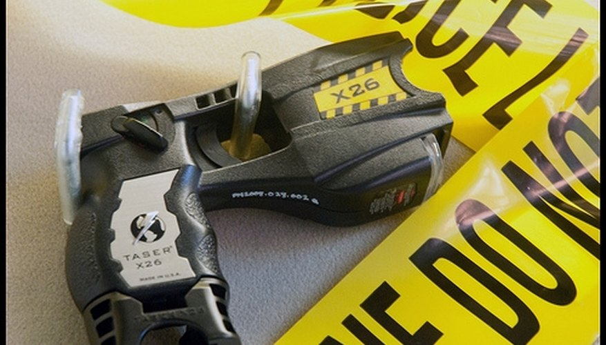 What Are the Pros & Cons of Taser Guns?