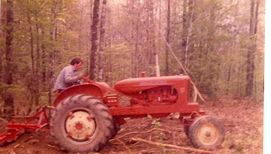 This older Allis-Chalmers was purchased for much less than a new tractor but still can perform many tasks such as grading.