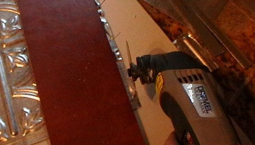 Power cutting tools make quick and easy work of cutting faux tin tile