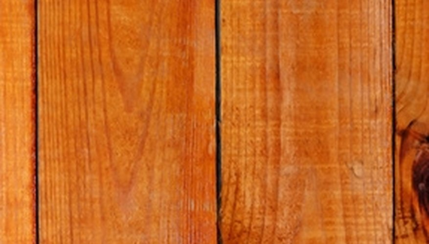The first row of hardwood is screwed in place to prevent shifting.