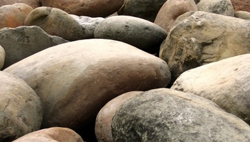 Use large rocks to keep the sacks in place.