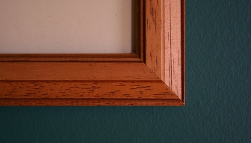 The corner of a picture frame has a routed edge.