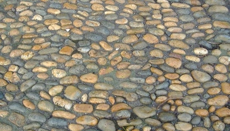 cobblestone pavers are a manufactured choice of patio stone that can add an old world charm to your property manufactured cobblestone pavers are available - Patio Stones