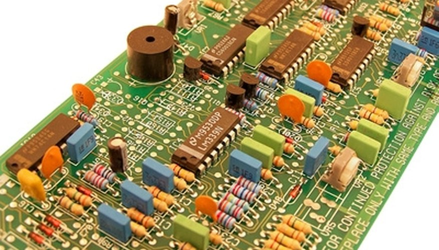 Wound inductor coils on circuit boards vary impedance based on frequency.