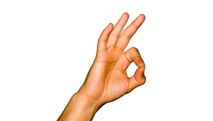Keep your other three fingers raised, so you do not trap them under the string.