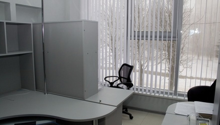 These desks are separated by storage for working privacy and allow for collaboration
