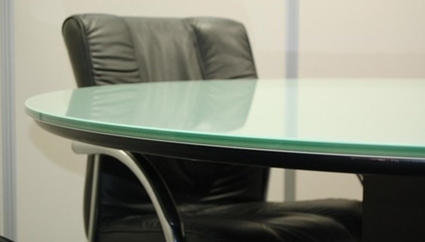 Glass table and conference chair