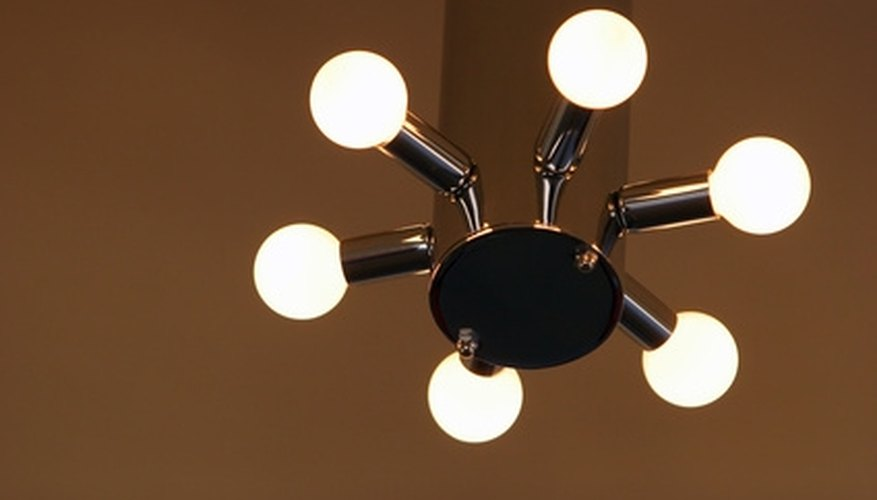 Replace outdated chandeliers with modern light fixtures.
