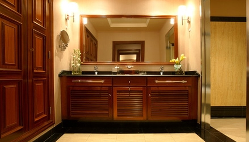 Use cabinets to create an upscale look in a master bathroom.