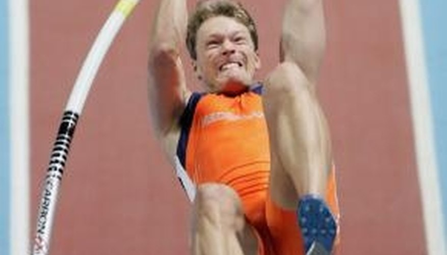 A pole vaulter wears specialized turf shoes.