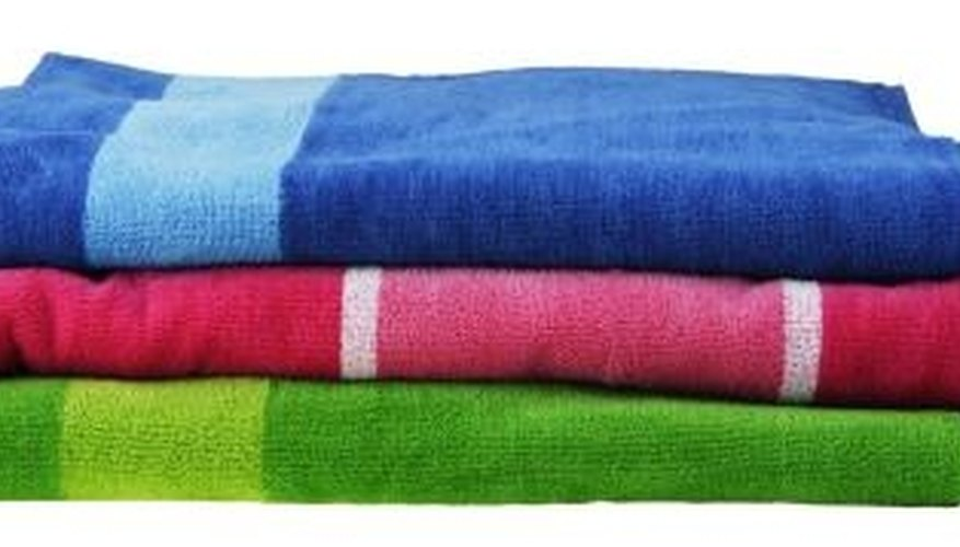 Absorbent towels remove excess moisture from wool garments.