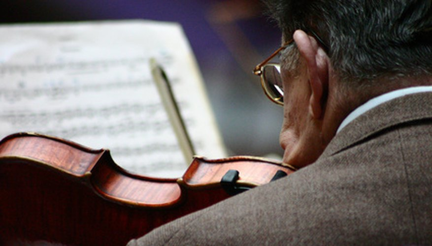 A violinist concentrates on his music.