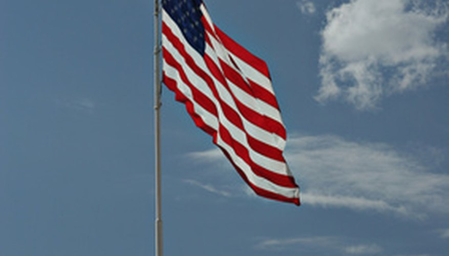 Flags can be hung on free standing poles or poles connected to walls