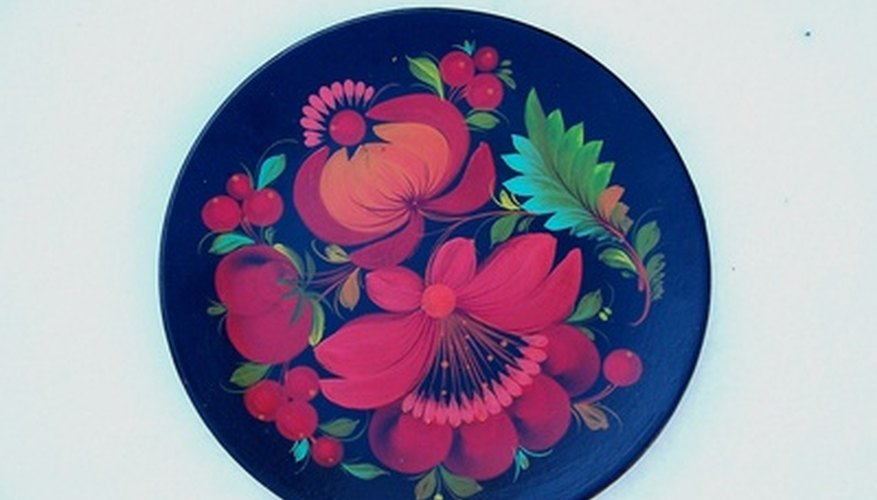 Use decoupage to create attractive plates.