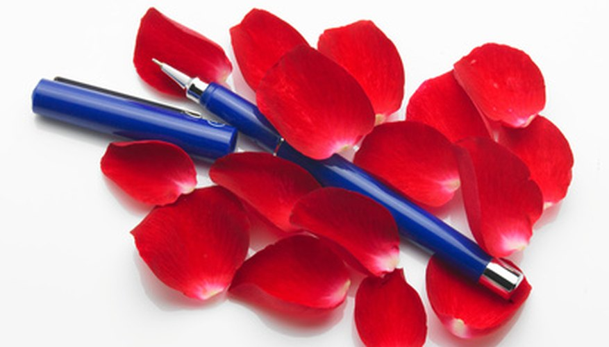 Using a pen or pencil to roll the edges of the rose petals gives a realistic appearance.