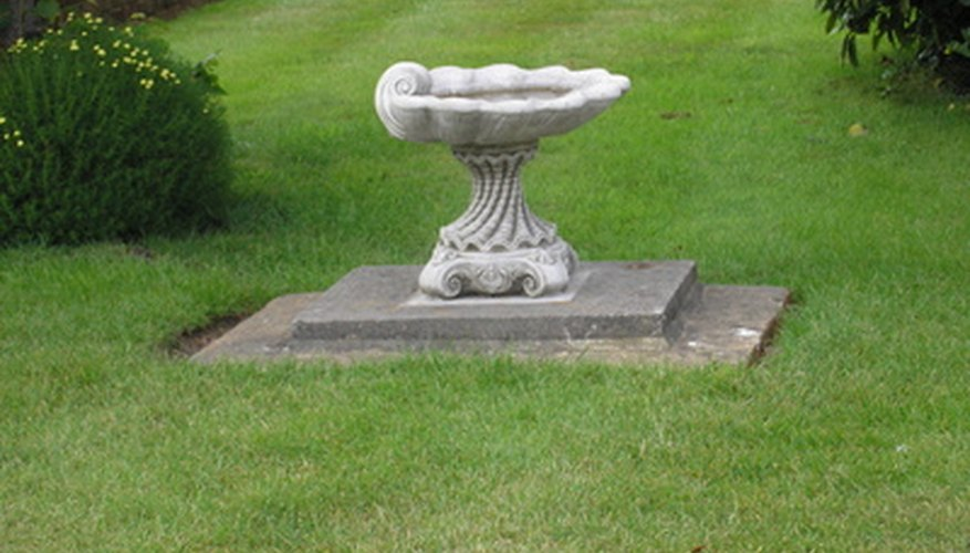 Add a bird bath to an area of your yard where grass won't grow.