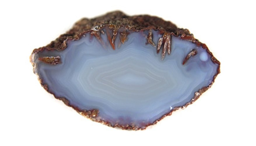 Agates are heavier than other rocks, have banded patterns and a waxy luster.