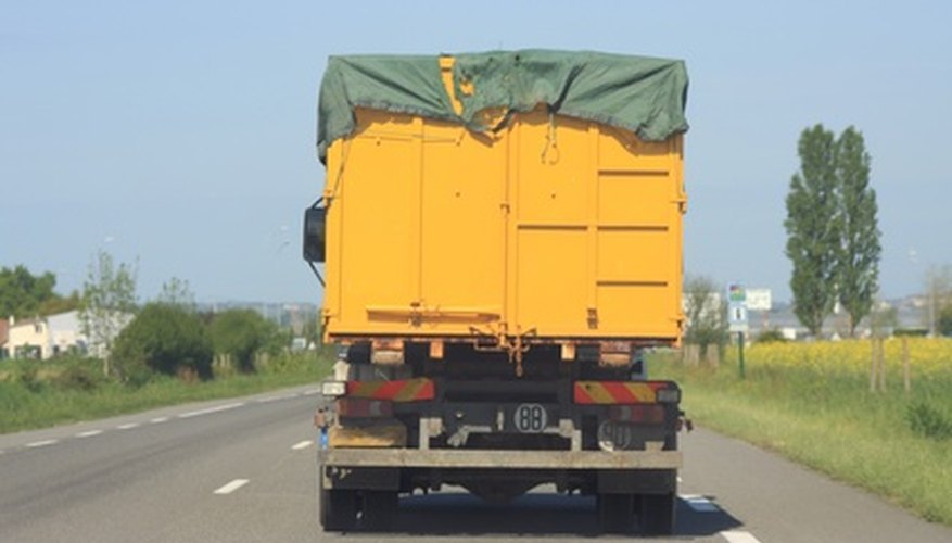 The advantages of using a tarp, such as the one on this truck, are durability and strong rivets for the bungee cords