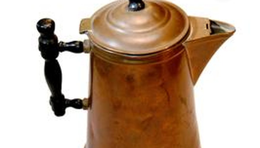 A patina can give an aluminum pitcher a copper color.