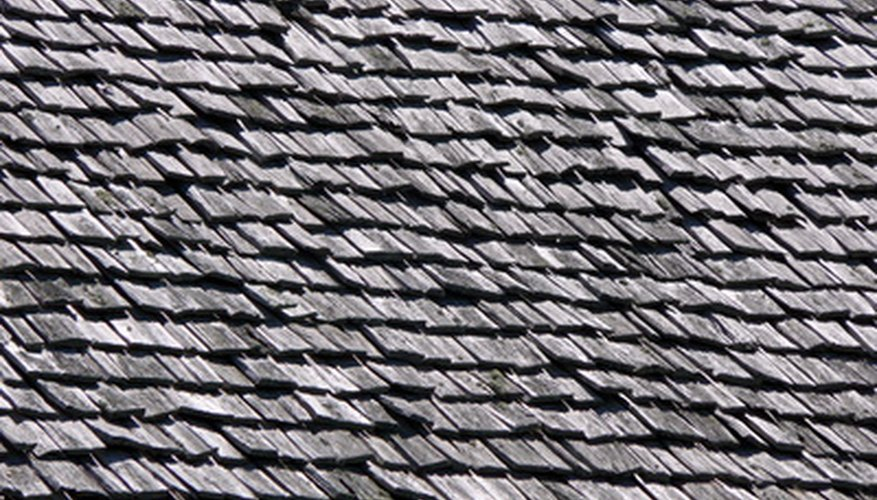 Wood Shingles Often Show Signs Of Natural Wear, Such As Fading And  Splitting.