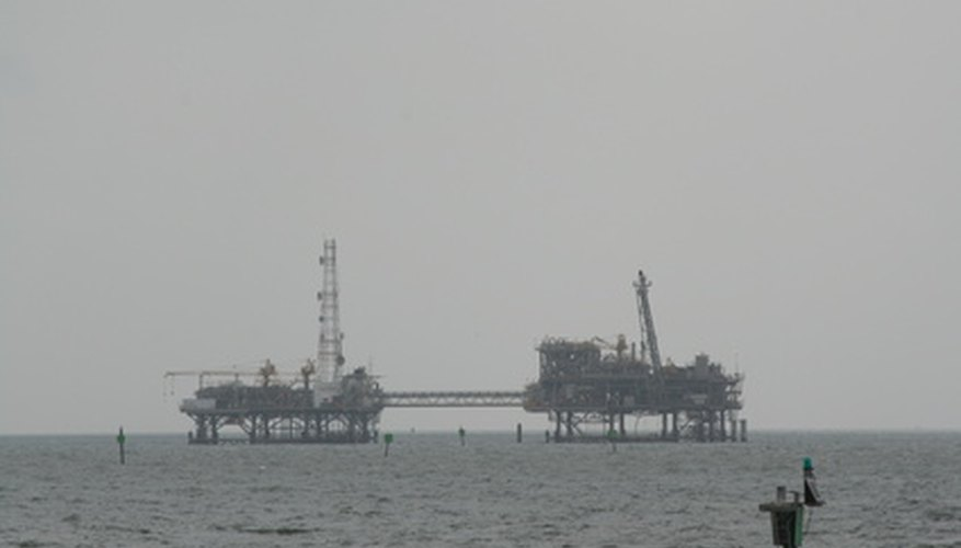 Oil rigs are often visible from the shores of gulf coast beaches in the United States.
