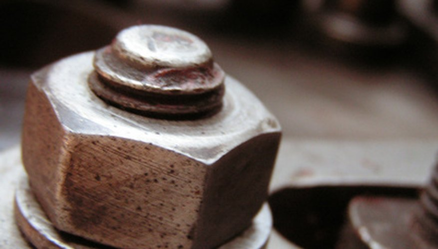 A nut and bolt have matched threads to tighten or loosen as they rotate.