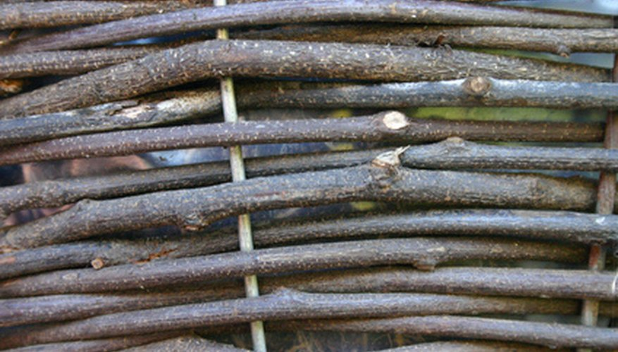 Wattle fence is woven from pliable sapling-size wood.