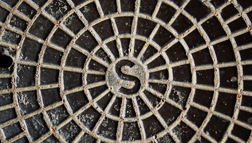 A manhole in your backyard possibly indicates presence of an easement.