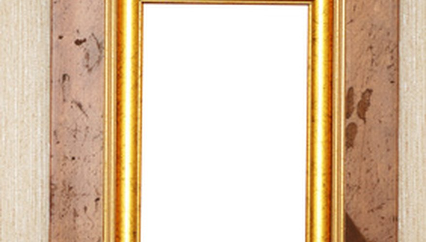 Antiquing with gold paint enhances everyday items, such as picture frames.