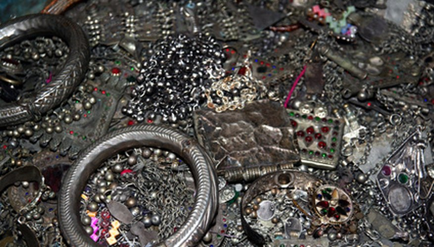 Recycle old jewelry into decorative art for your home.