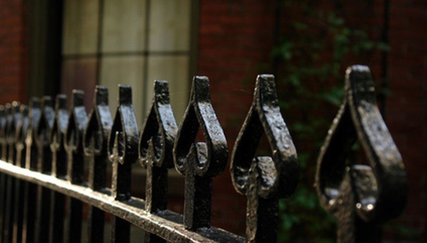Fencing in a wrought-iron style evokes the feel of Spain.