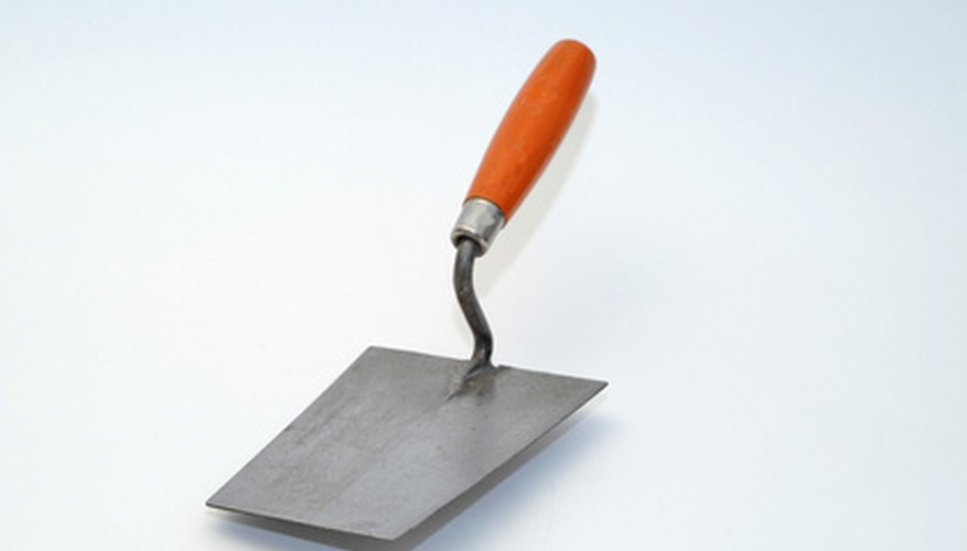 Use the flat edge of the trowel to smooth out any repaired areas.