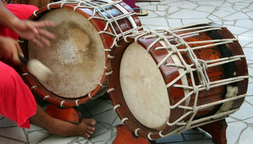 Tambora drums are played with sticks in Venezuela's gaita music style.
