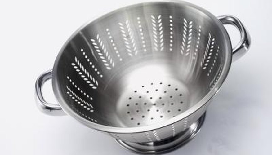 An old steel colander can be re-purposed as a chimney cowl.