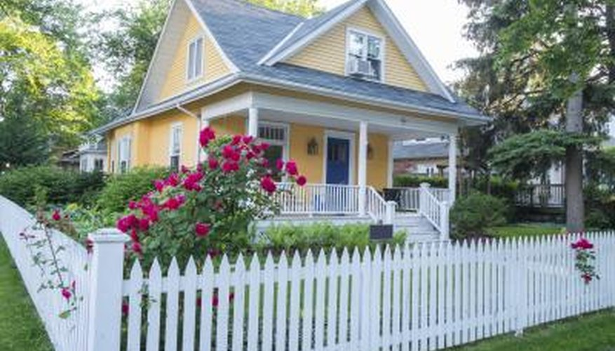 White picket fence with bungalow landscape