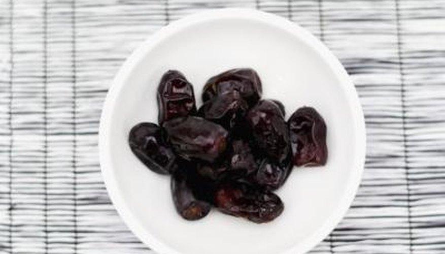 Bowl of dried prunes.