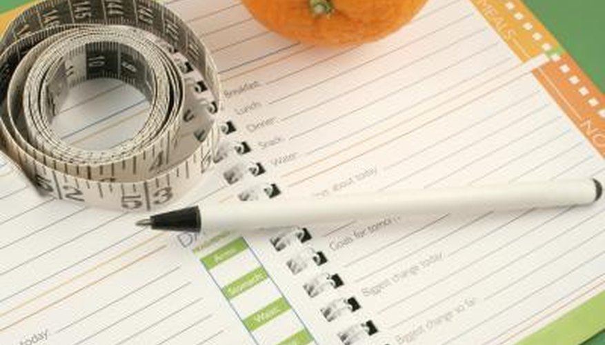 Track your food intake and weight loss in a journal.